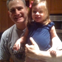 Prior to heading to the chalk-talk breakfast, Peanut poses with Daddy