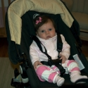 Sara in her newly reconfigured chair stroller