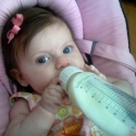 Holding her own bottle