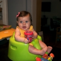 Sitting in her new bumbo seat, watching daddy cook!
