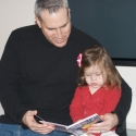 Daddy and Sara reading a new book